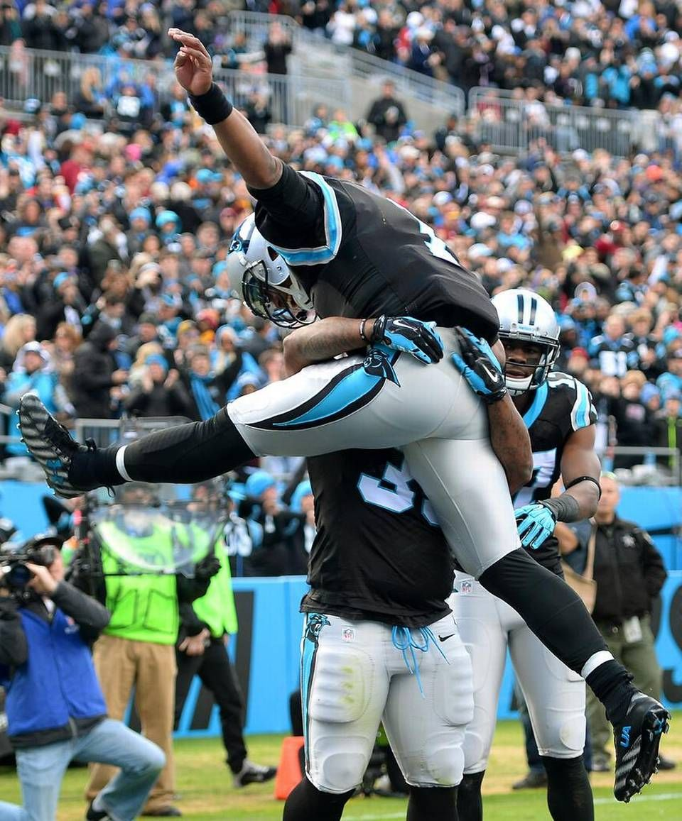 Carolina Panthers quarterback Cam Newton leaps into the