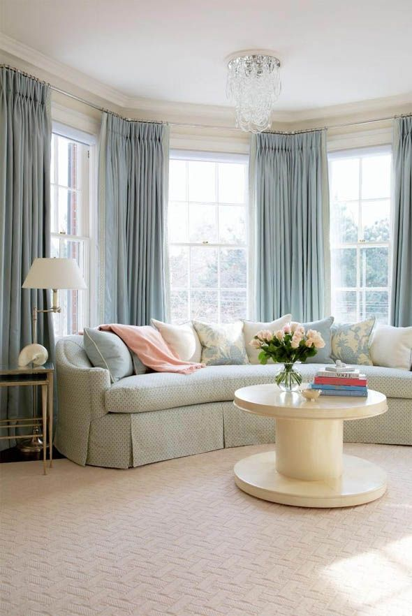 Double Sets Of Pinch Pleat Curtains With A Curved Sofa Bay Window