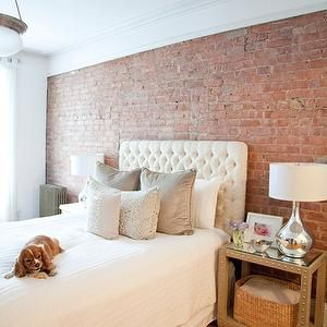 the elegant abode bedrooms exposed brick wall white tufted headboard - Exposed Brick Wall Bedroom Ideas