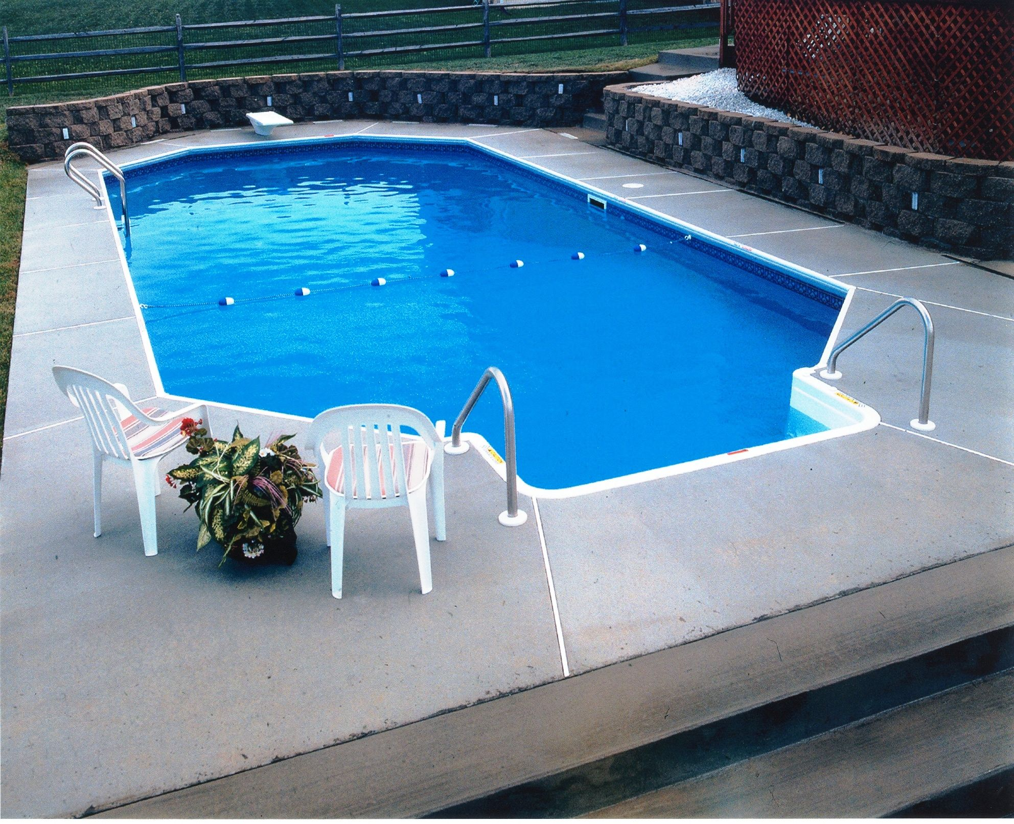 Grecian style pool featuring a brushed concrete deck and for Grecian swimming pool