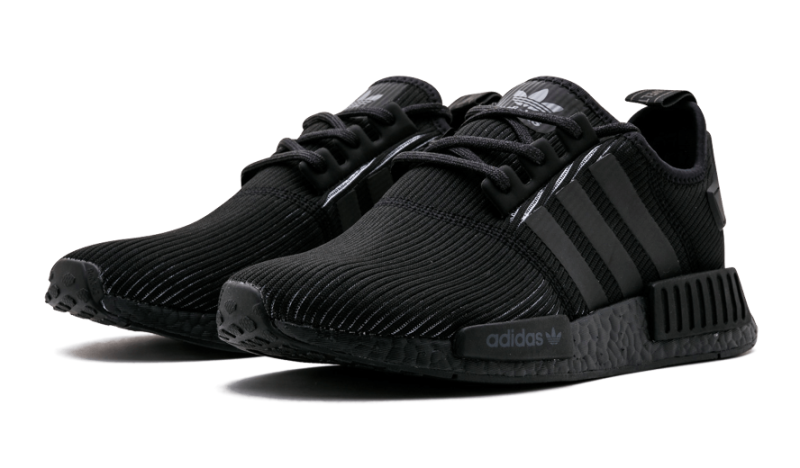 0968dcf1c5fb6 Triple Black Adidas NMDs with a corduroy upper are appearing in sneaker  stores now.