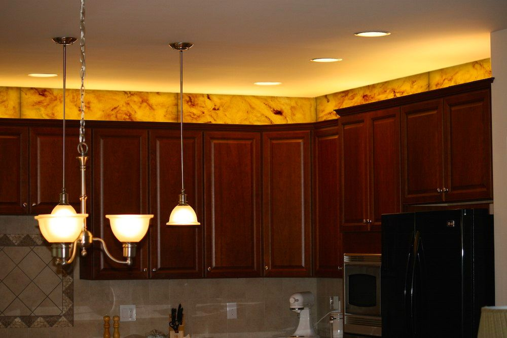 Modular Corner Lights Used Above The Kitchen Cabinetry To Give A Striking Look