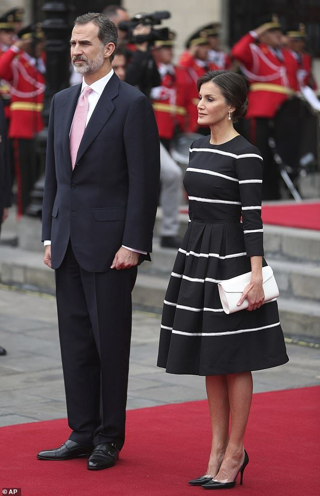 Queen Letizia looks elegant as she and King Felipe land in Peru