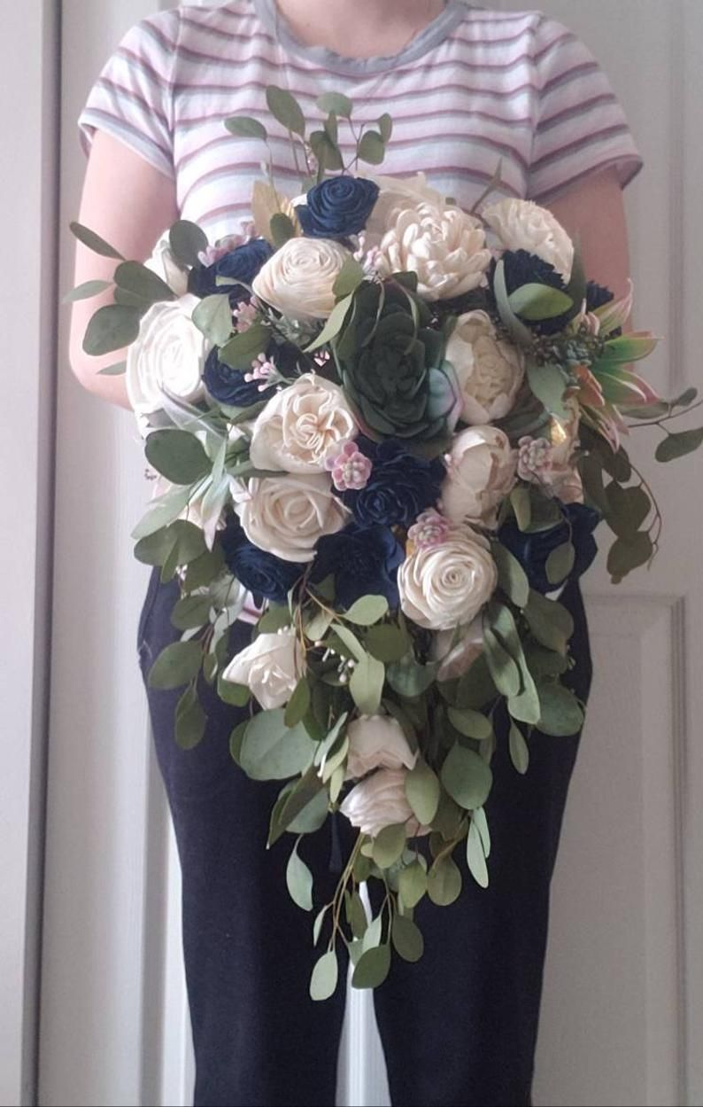 Ivory and navy blue cascading bouquet with blush and gold