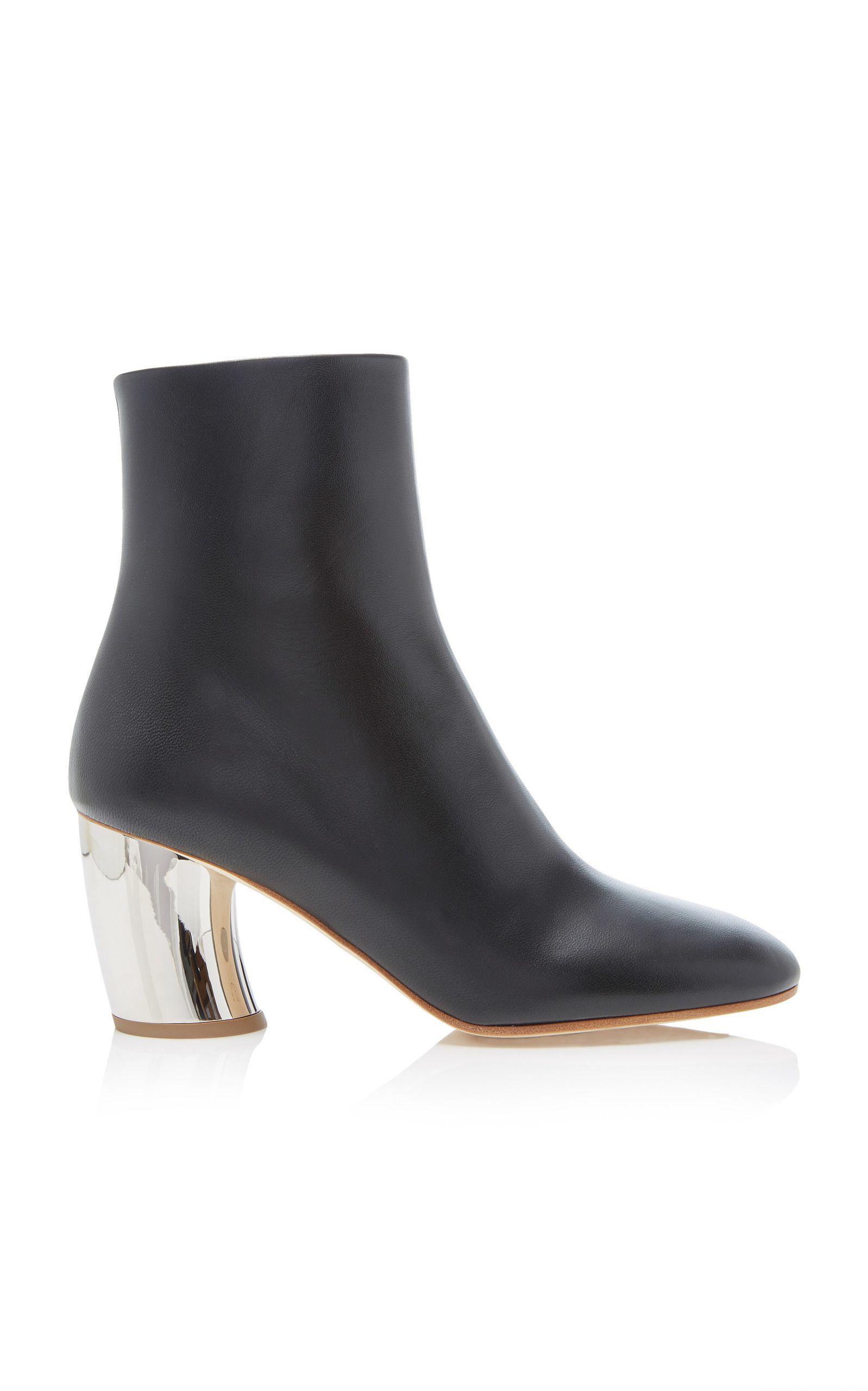 black boots with metallic heel