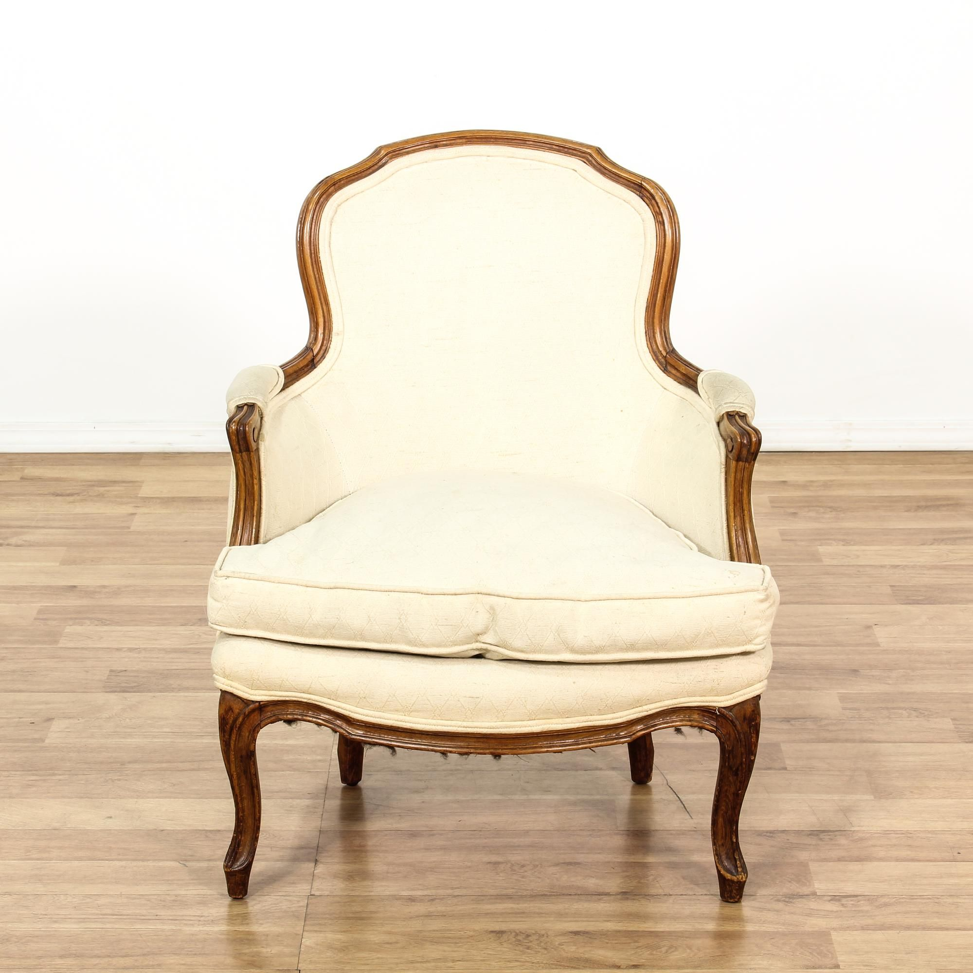 This Louis XV style bergere chair is upholstered in an off white