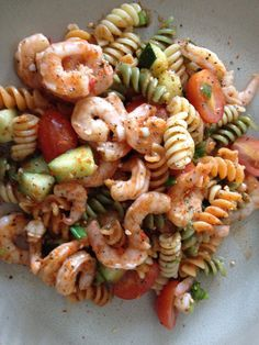 Pasta salad with shrimp, grape tomatoes, cucumber, scallions, salad supreme seasoning, and bell pepper Italian salad dressing.