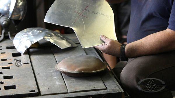 Tony Shapes Sheet Aluminum Into The Rough Hemispheres Of The Half Helmet Using A Leather Sandbag A Plastic Mallet And Tony S Unc Metal Fabrication Metal Half Helmets