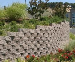 Basalite Retaining Walls And Landscape Garden Walls Transform Your Outdoor Living Space From The Ground Up With B Garden Wall Outdoor Living Landscape Walls