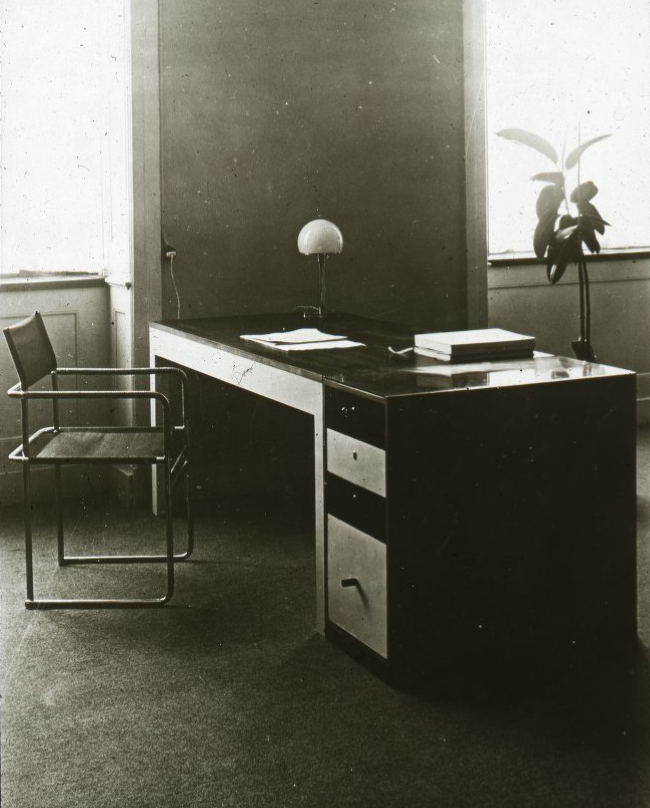Marcel Breuer, Interior with Desk and Tubular Steel Chair, House of Ludwig Grote,1926. Also shown: The table lamp of Wilhelm Wagenfeld. Bauhaus Dessau. Unknown photographer. Via Marcel Breuer Archives