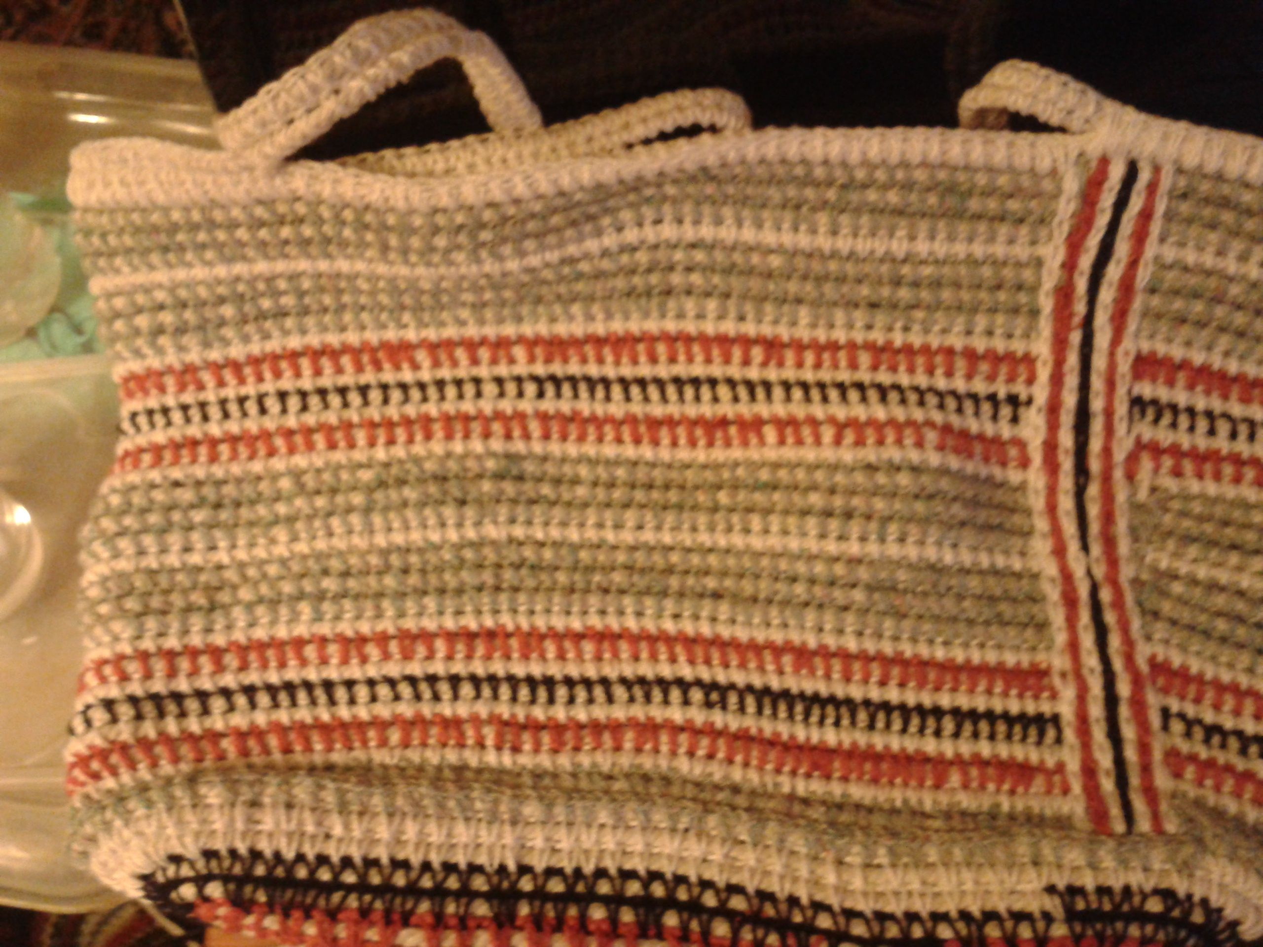 I made this bag by crocheting over 6mm piping cord and then continuing round going over more cord into the stitches below It makes a very strong but flexible fabric.