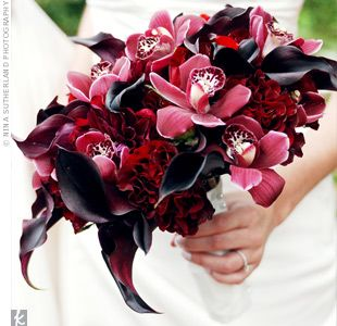 red and plum orchids, calla lilies and....roses maybe?