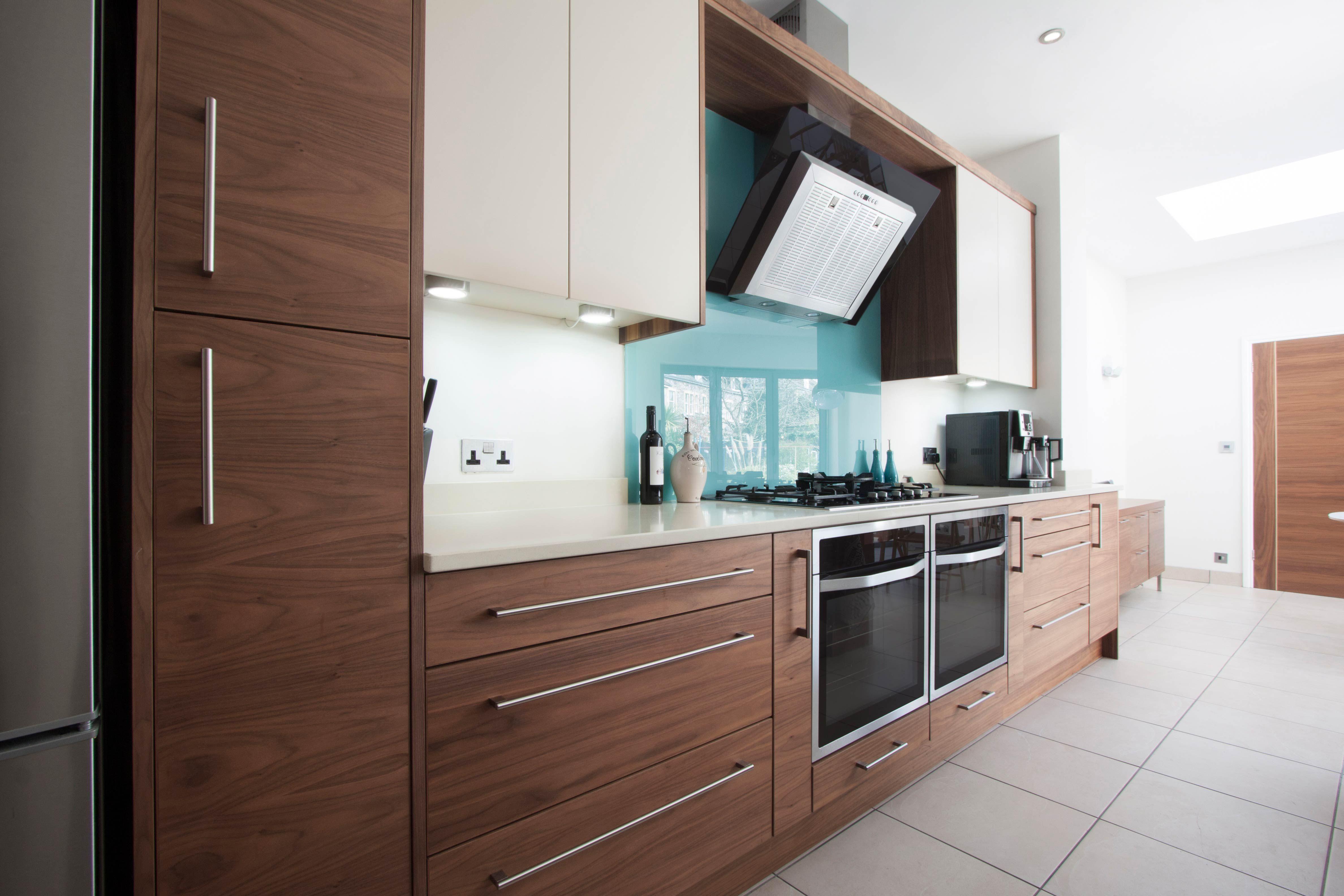 Number eighty one veneered walnut lacquered flat slab kitchen door with arenastone