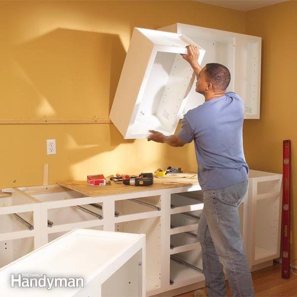 install kitchen cabinets—base, wall and peninsula—using