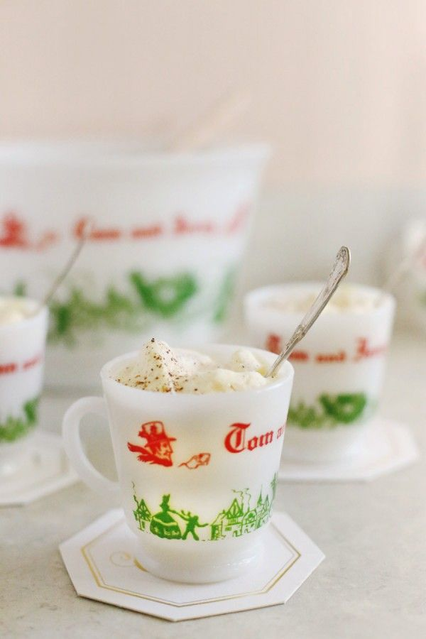 Foreground crisp, shallow blurry background.   Tom and Jerry Xmas Drink Recipe from Sweetest occasion