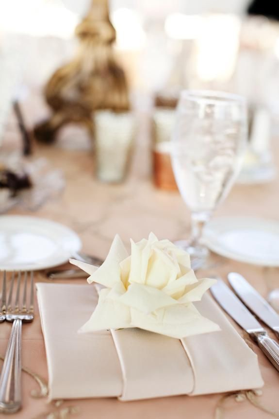 The Depot Wedding Minneapolis, MN party rental. Photo by Photogen, Inc. -- blush satin linen with gold lattice overlay and champagne satin napkin folded into a cummerbund with a single cream colored rose head resting on top. -- #TheDepot #Minneapolis