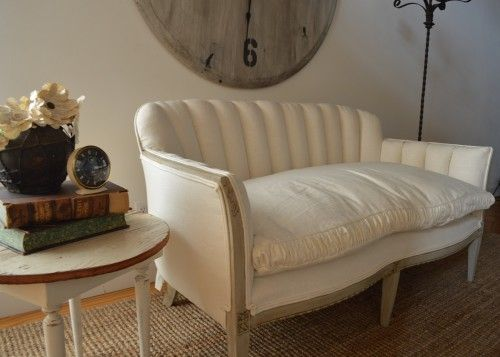 Antique sofa upholstered in white linen. $1195
