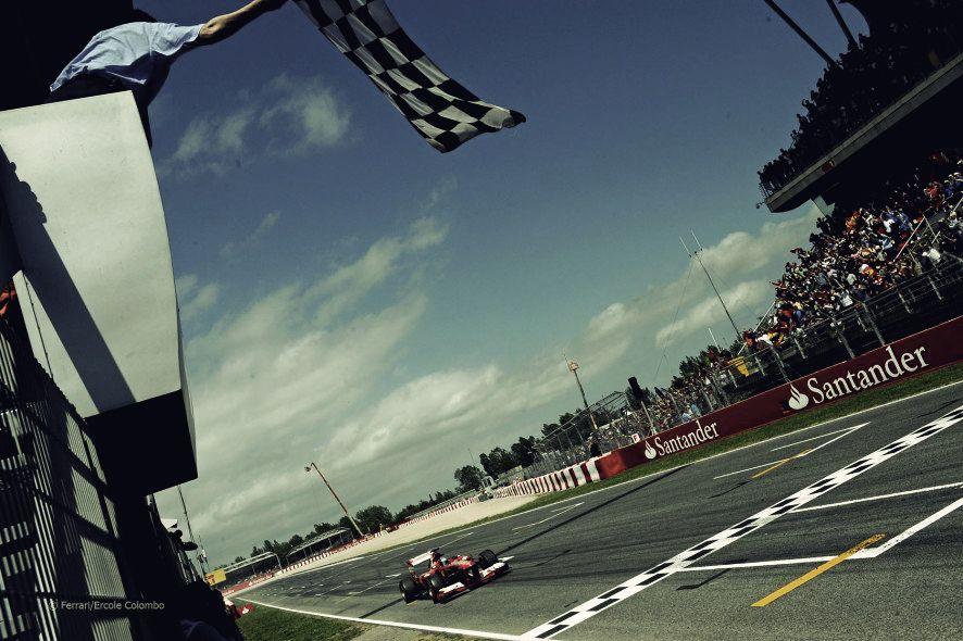 Fernando Alonso crosses the line to win the Spanish Grand Prix
