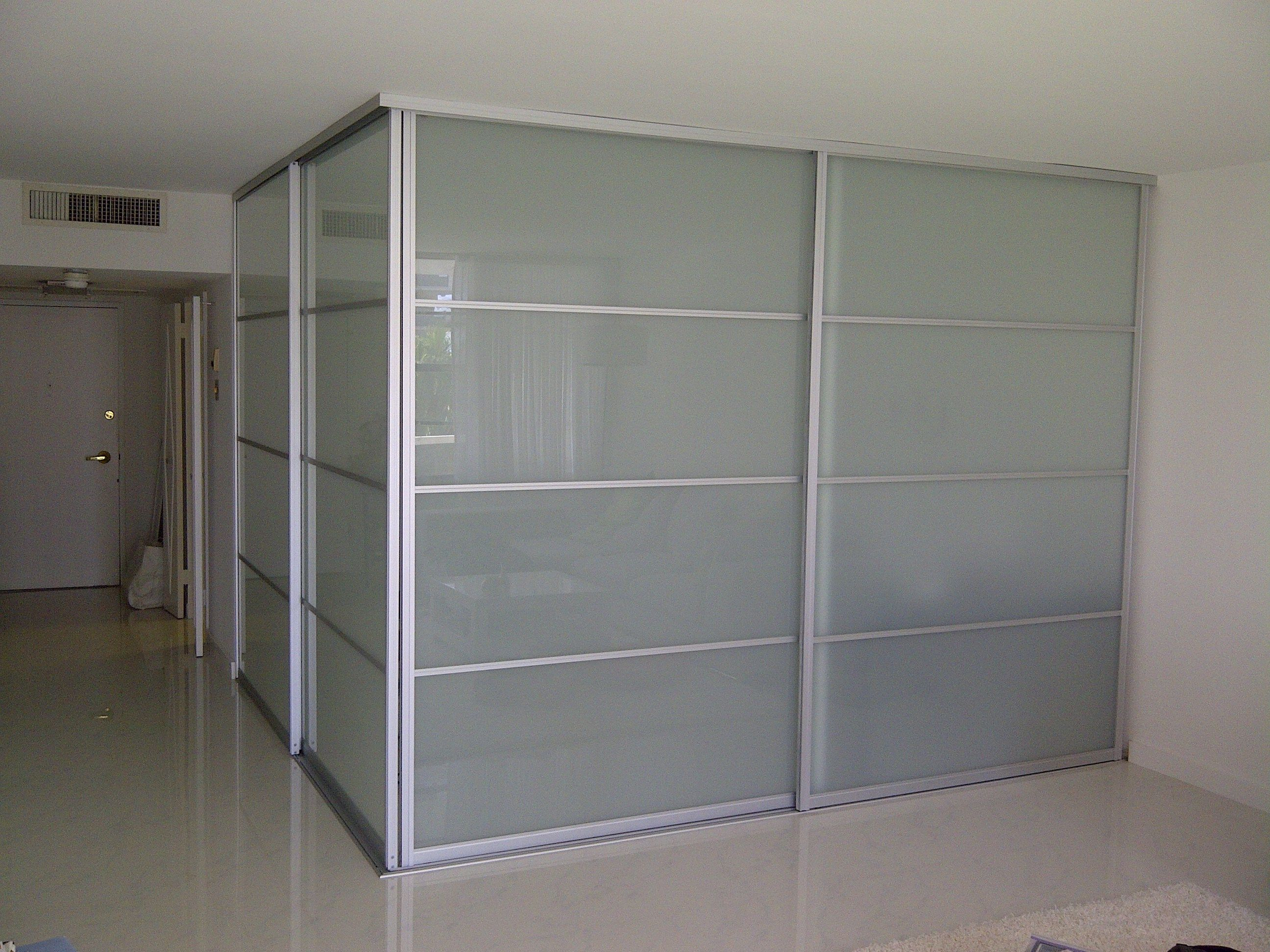 Interior sliding glass doors room dividers - Frosted Glass Sliding Room Divider With Alumunium Frames Connected By White Wall And White Floor