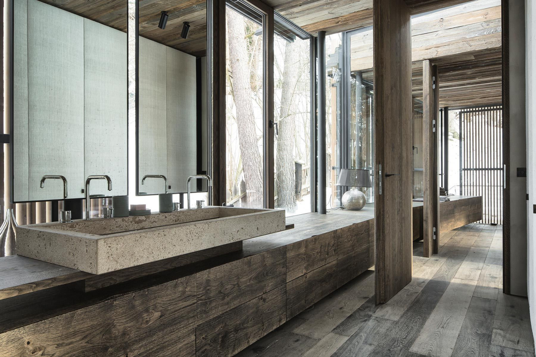 Modern wood and glass bathroom (is the sink made of concrete?)