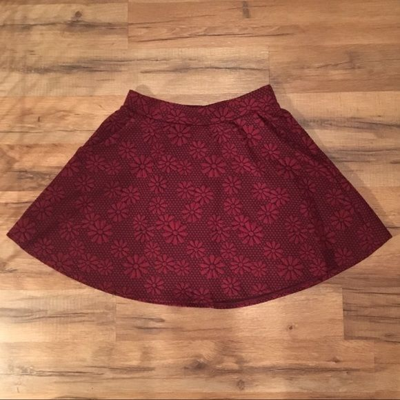 Burgundy skater skirt Floral burgundy skater skirt brand new never worn. tag says small but Im a small and I feel like this fits like a medium Skirts Circle & Skater