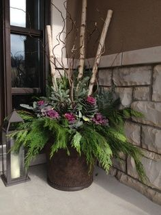 """Decorating Front Porch Urns For Christmas Love The """"branches"""" In This Arrangement Garden & Outdoor Ideas"""