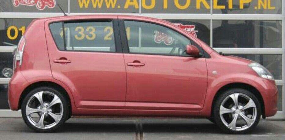 Pink Daihatsu Sirion