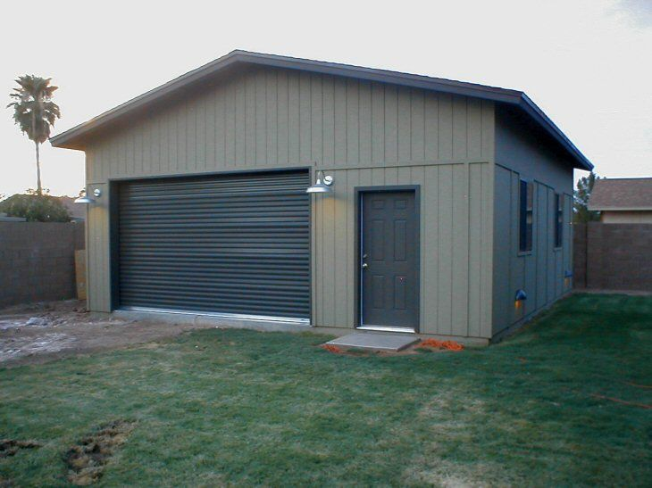 A Modern House Design with Metal and Glass Garage Doors Garage