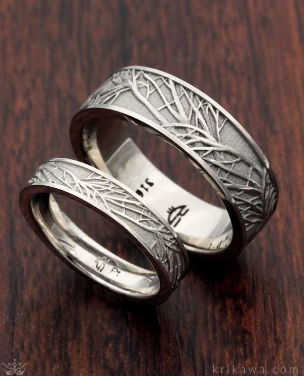 His and hers matching Tree of Life Wedding Bands in stainless steel and platinum…