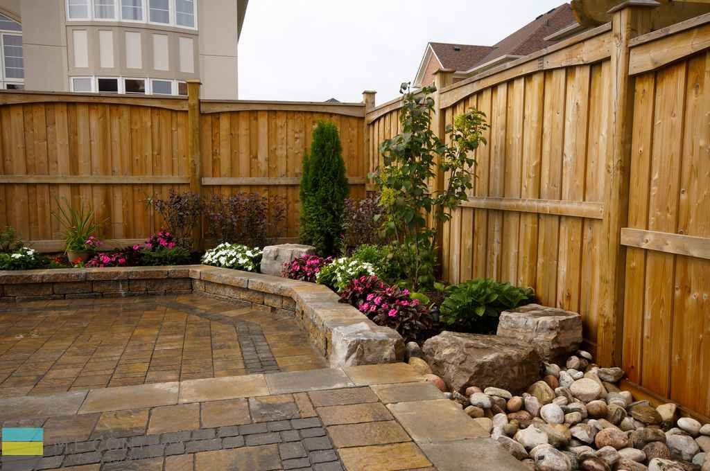 2 level interlock patio with retaining walls and large ... on 2 Level Backyard Ideas id=69104