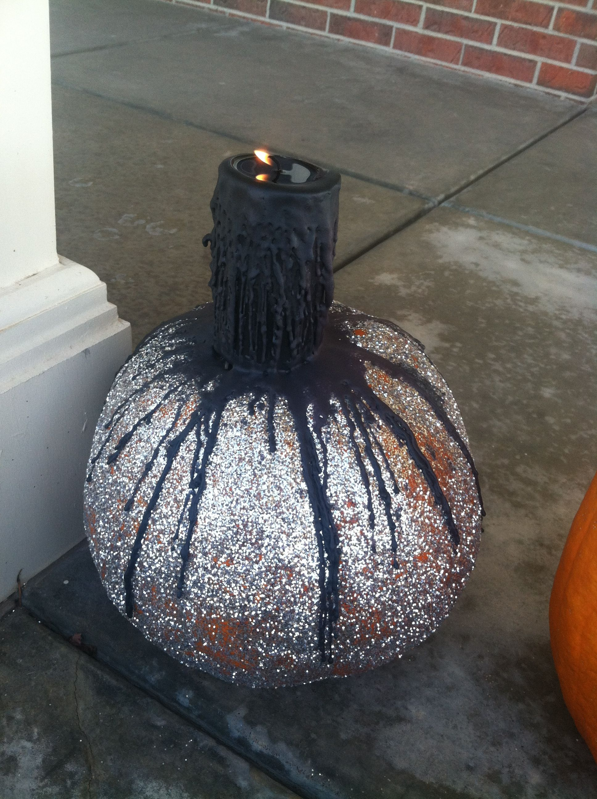 Melted candle over glittered pumpkin instead of waiting for it to