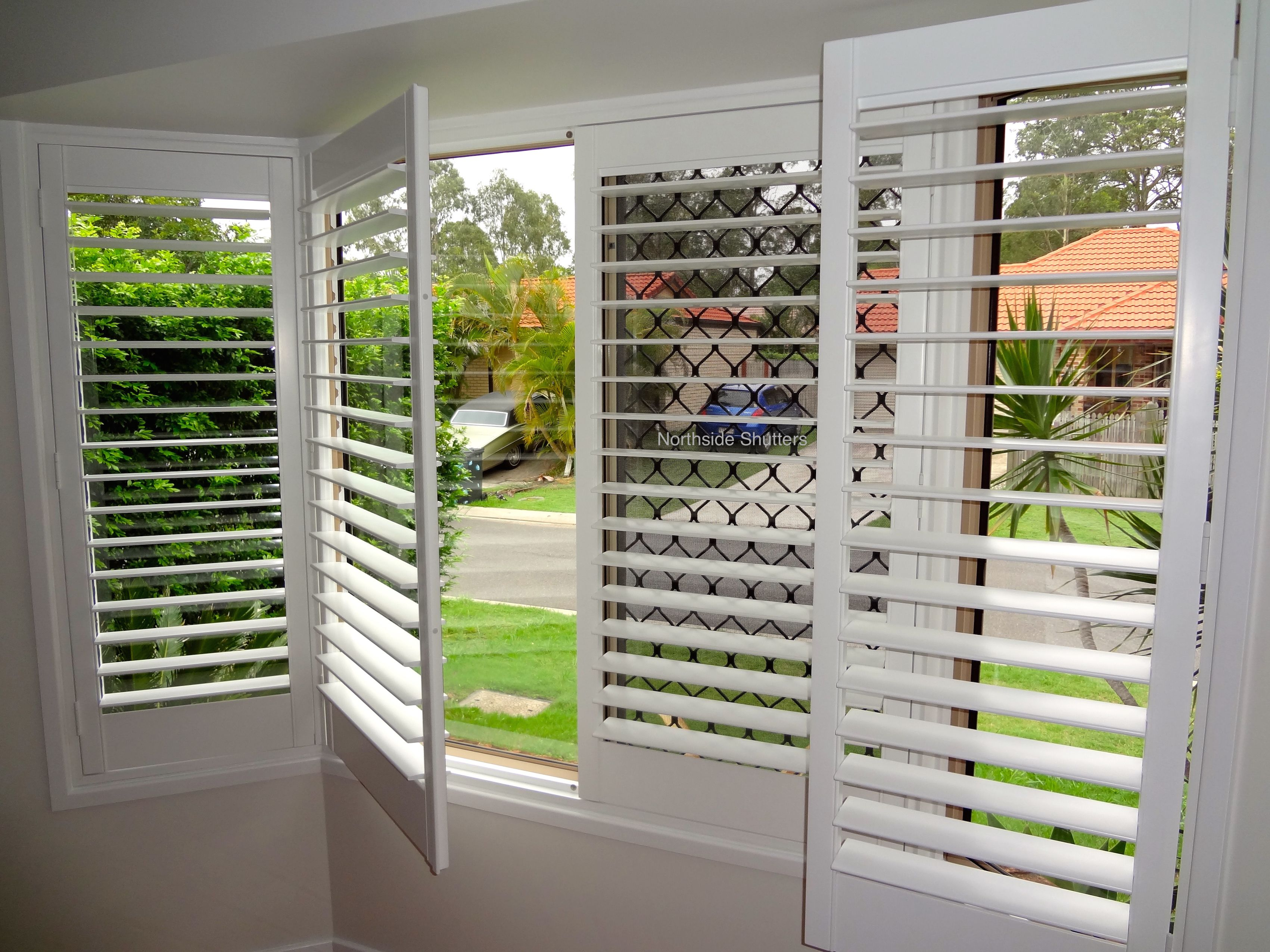 Hinged Plantation Shutters In A Bay Window Custom Made To Fit