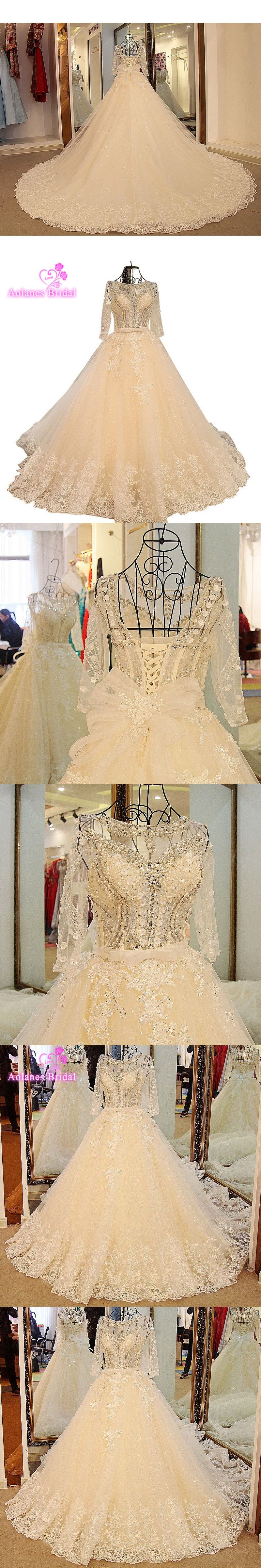 Wedding dresses with rhinestones  Luxurious Bling Royal Train Wedding Dresses Sheer Bridal Crystal