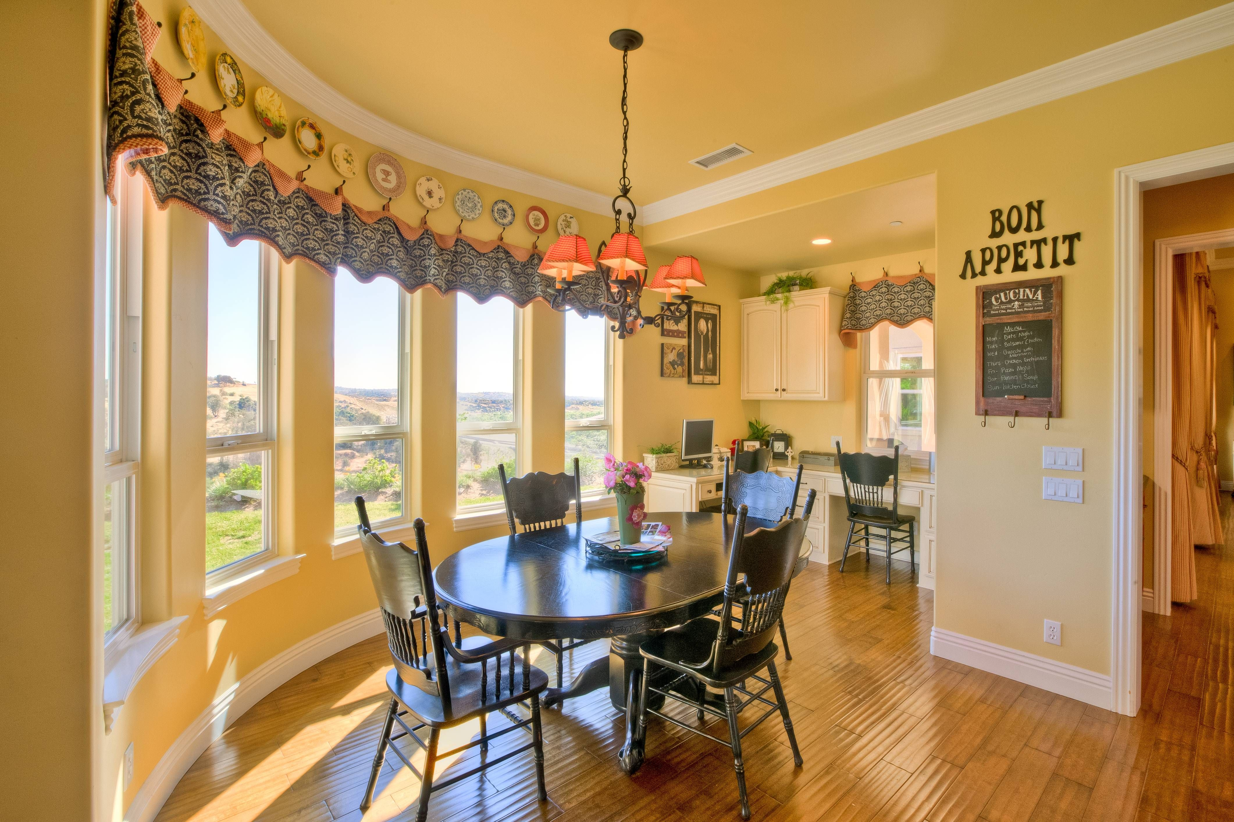 This Eat In Area Is One Of The Finest You Ll Ever Find Five Tall Bay Windows Drench The Home In Natural Light And Showcase Lovely With Images Bay Window Home Decor