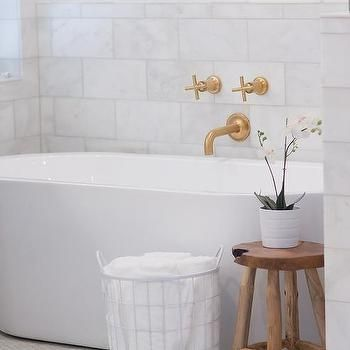 Relaxing Clean Bathroom Space Featuring A White Oval Freestanding Tub Gold Faucet Wooden Sto Freestanding Bathtub Faucet Wall Mount Tub Faucet Bathtub Walls