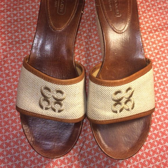 Coach Platform Wedges Coach Women's Jaci Open Toe Slides Tan/Brown Straw Logo Platform Wedge Heel.  Good condition.  Top of shoes are clean and stain free. Coach Shoes Platforms