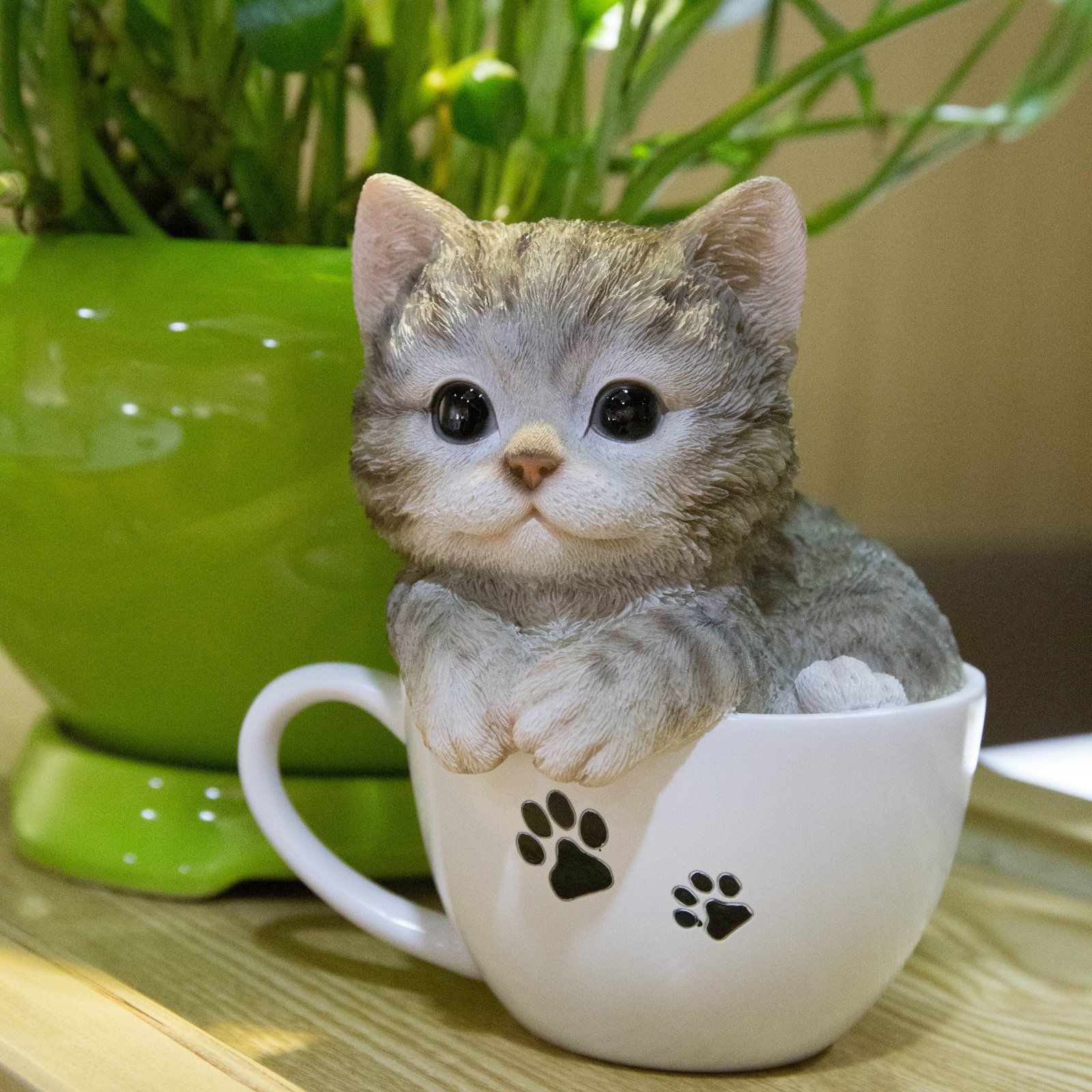 Dimensions: 5.25L x 5W x 5.75H in.. Crafted out of polyresin. Depicts kitten in teacup. Gray and white finish. Weight: .88 lbs.. Your kitchen décor will be un-fur-getable when you have the Hi-Line Gift Ltd. Teacup Kitten Grey Tabby Statue on display. The playful polyresin sculpture depicts a tiny gray kitten filling a white paw print-patterned teacup - 87707-B.
