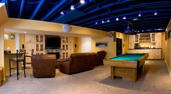 This Basement Game Room Has A Cool Exposed Ceiling Basement Lighting Exposed Basement Ceiling Basement Ceiling Painted
