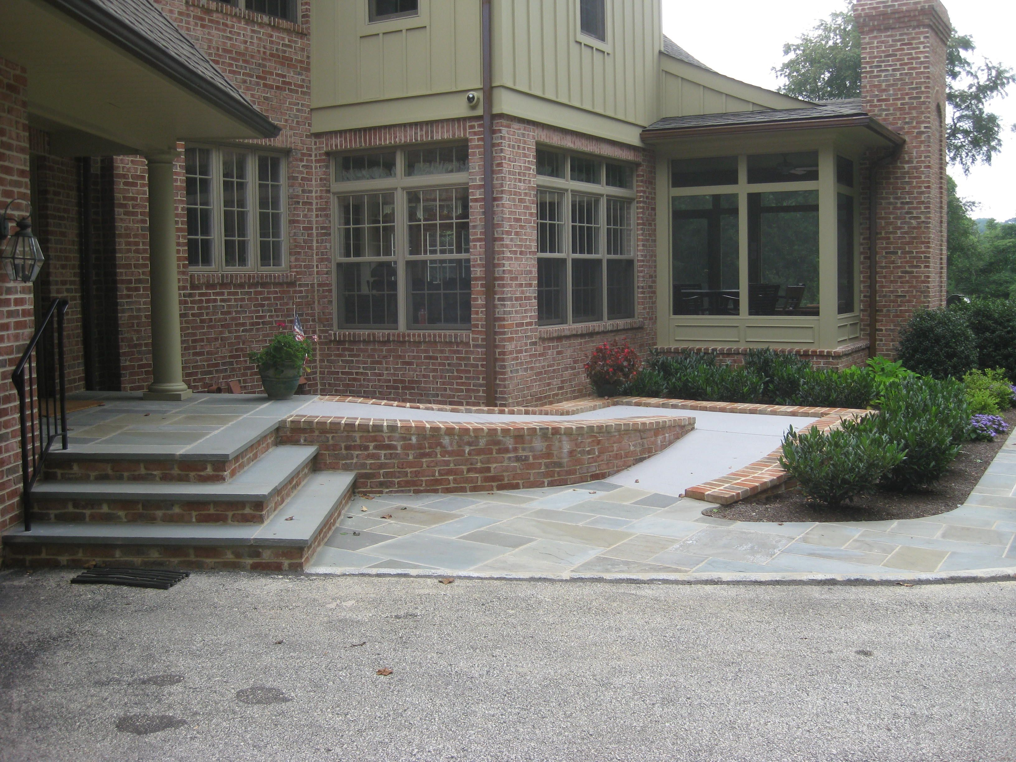 Flagstone and brick steps and heated handicap ramp for Stone porch designs