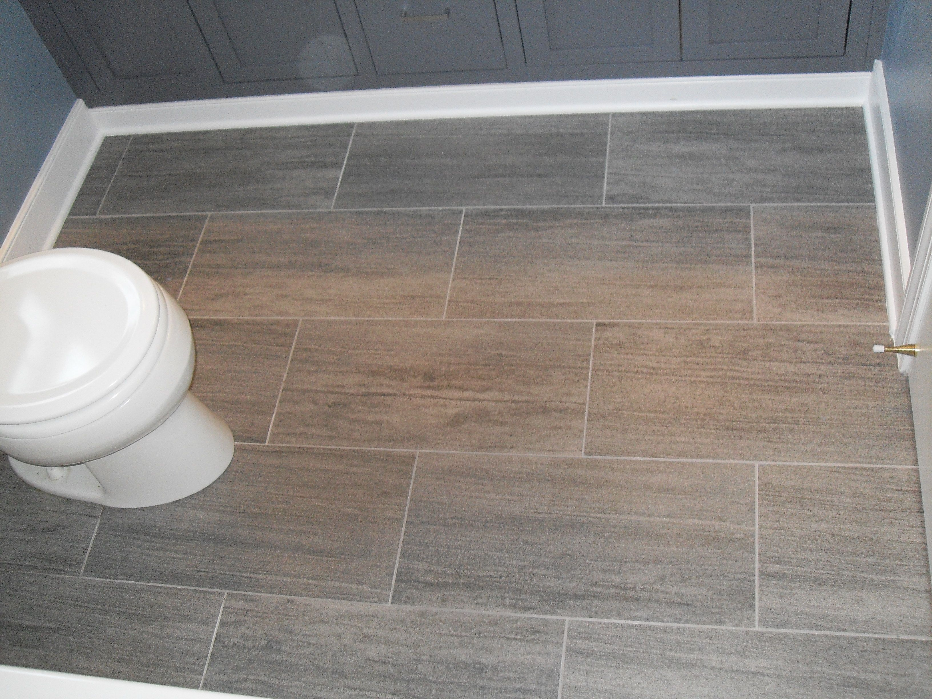 The Bathroom Floor Tile Ideas with Grey Porcelain Floor and