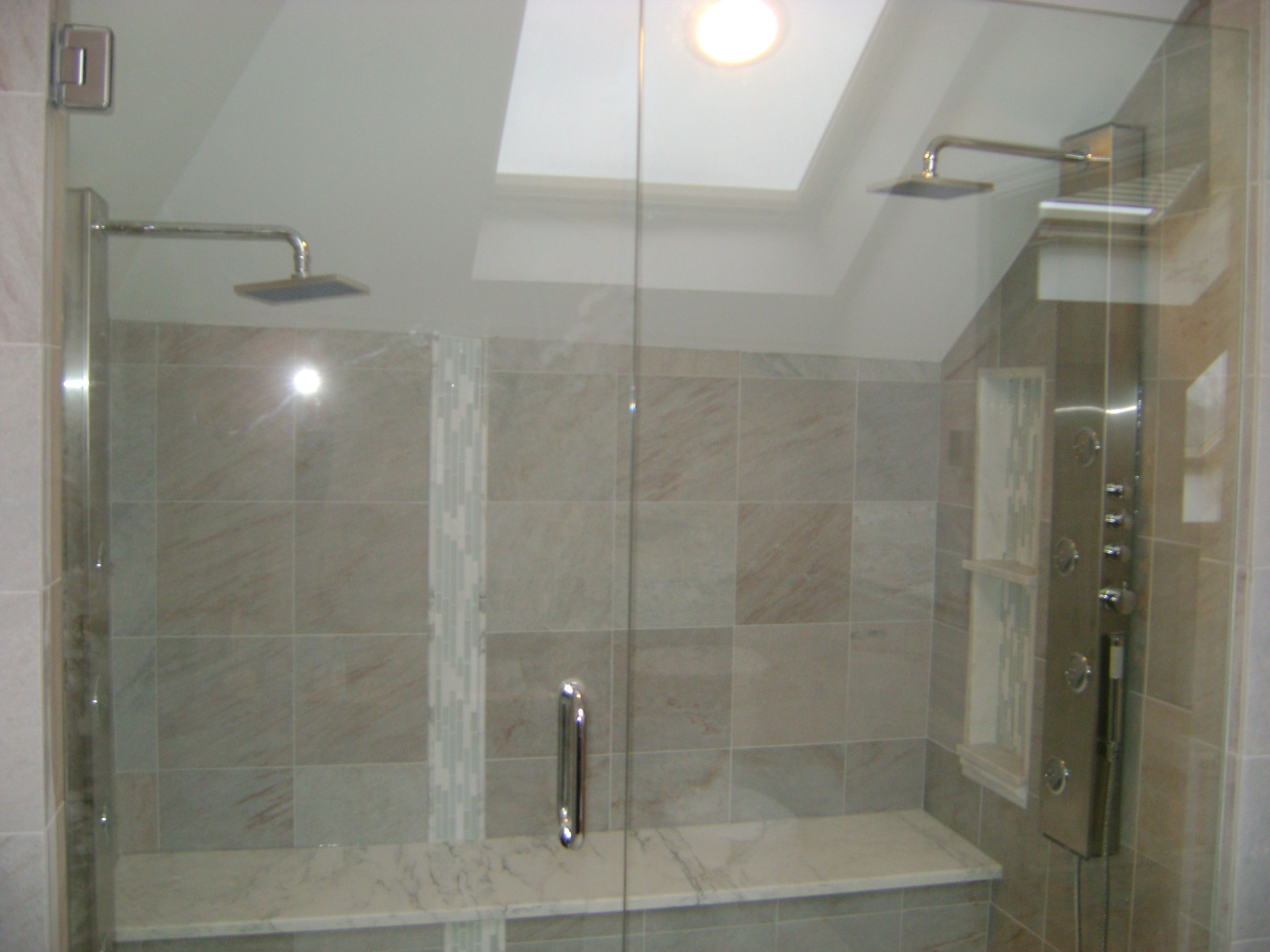 This shower features heated floors, a heated seat, and two full ...