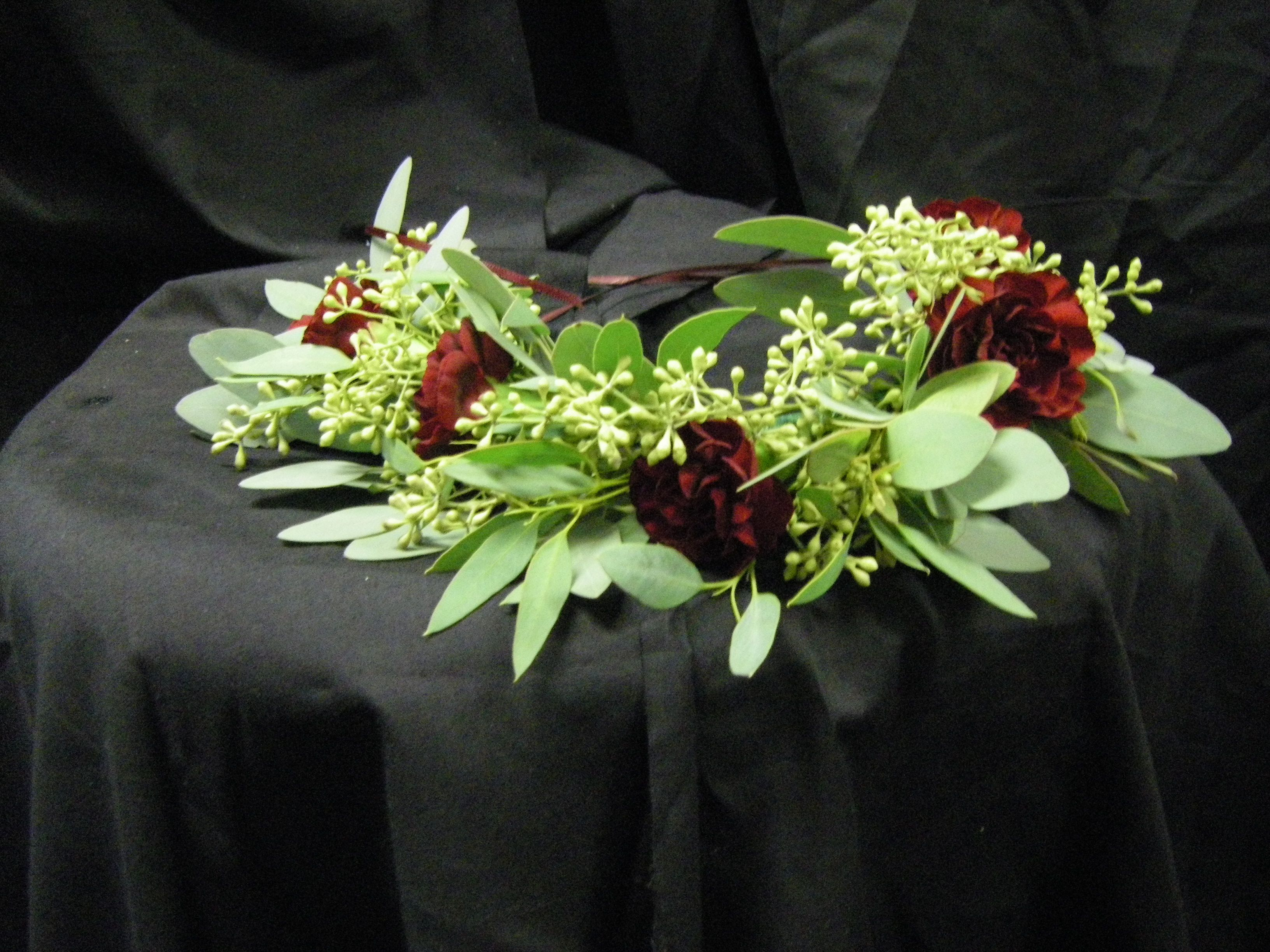 Flower crown with burgundy carnations and seeded eucalyptus our order flowers online with same day delivery from stillings embry florists fresh flowers and hand delivered right to your door in lewiston and surrounding izmirmasajfo Images
