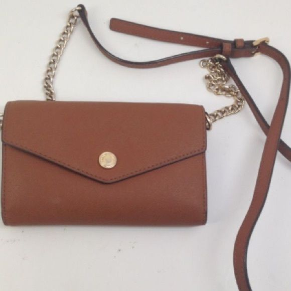 "100% authentic Michael Kors small Crossbody small Crossbody phone handbag brown pre-own Minor scratches on the front button from leather and the back inside looks perfect please see pictures 4.25"" h  1.25"" w 6.25"" L Michael Kors Bags Crossbody Bags"