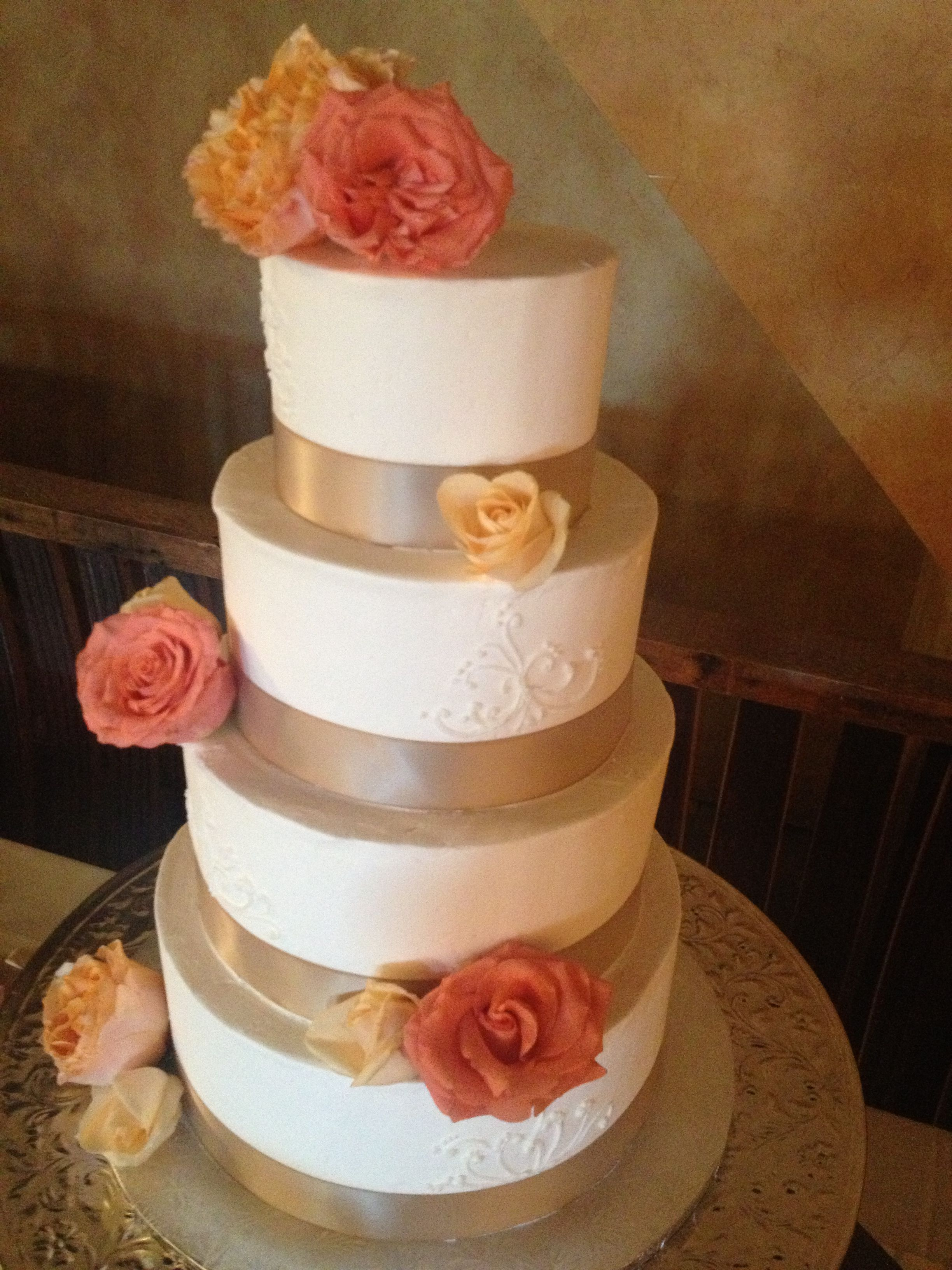 Coral and champagne wedding cake   Champagne Gold, Peach and Coral ...