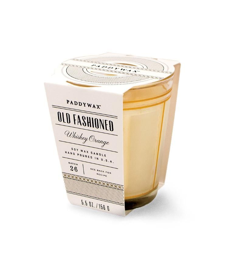 Mixology Candle - Whiskey Orange - A retro geometric design on the tapered old-fashioned glass that contains the Whiskey Orange Mixology Candle contributes to its sense of vintage bonhomie. Scented with the aromas of a classic craft cocktail and packaged with a recipe for mixing it up anew, this fragrant soy candle is a cheeky choice for your home or a clever, high-quality host gift.