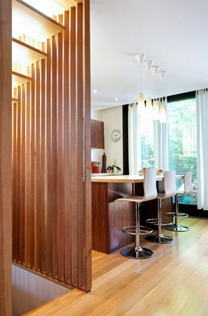 Exposed Stairwell Slat Wall And Light Filtering Through Wood