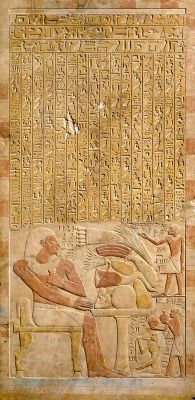 """Stela of Mentuwoser, Egypt, Middle Kingdom, reign of Senwosret I, circa 1944B.C., courtesy of the Metropolitan Museum of Art: """"This rectangular stone stela honors an official named Mentuwoser. Clasping a piece of folded linen in his left hand, he sits at his funeral banquet, ensuring that he will always receive food offerings and that his family will honor and remember him forever. To the right of Mentuwoser, his son summons his spirit. His daughter holds a lotus, and his ..."""