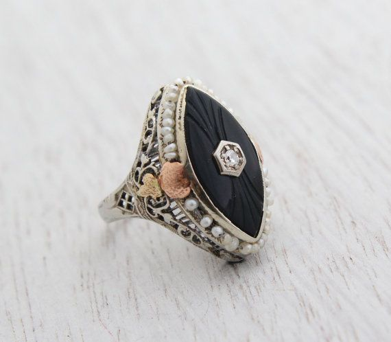 Hey, I found this really awesome Etsy listing at http://www.etsy.com/listing/163814789/antique-art-deco-14k-white-gold-filigree