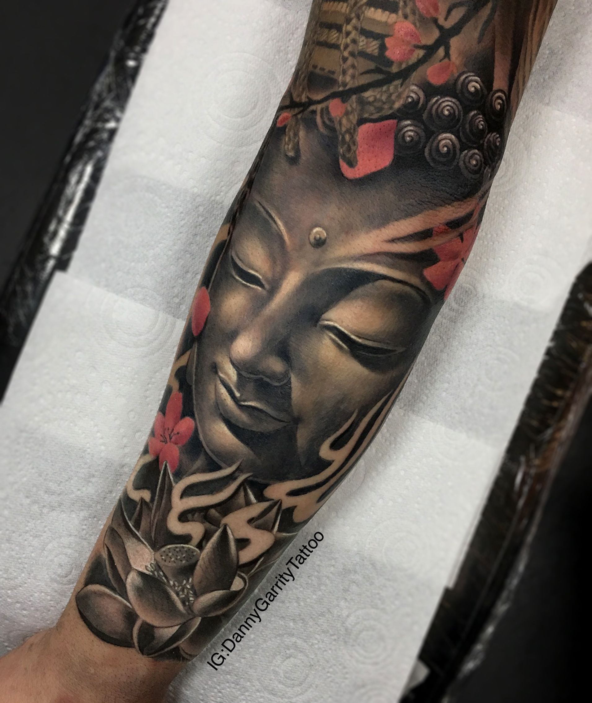 Realistic Black And Grey Buddha Face Tattoo With Lotus Flower And