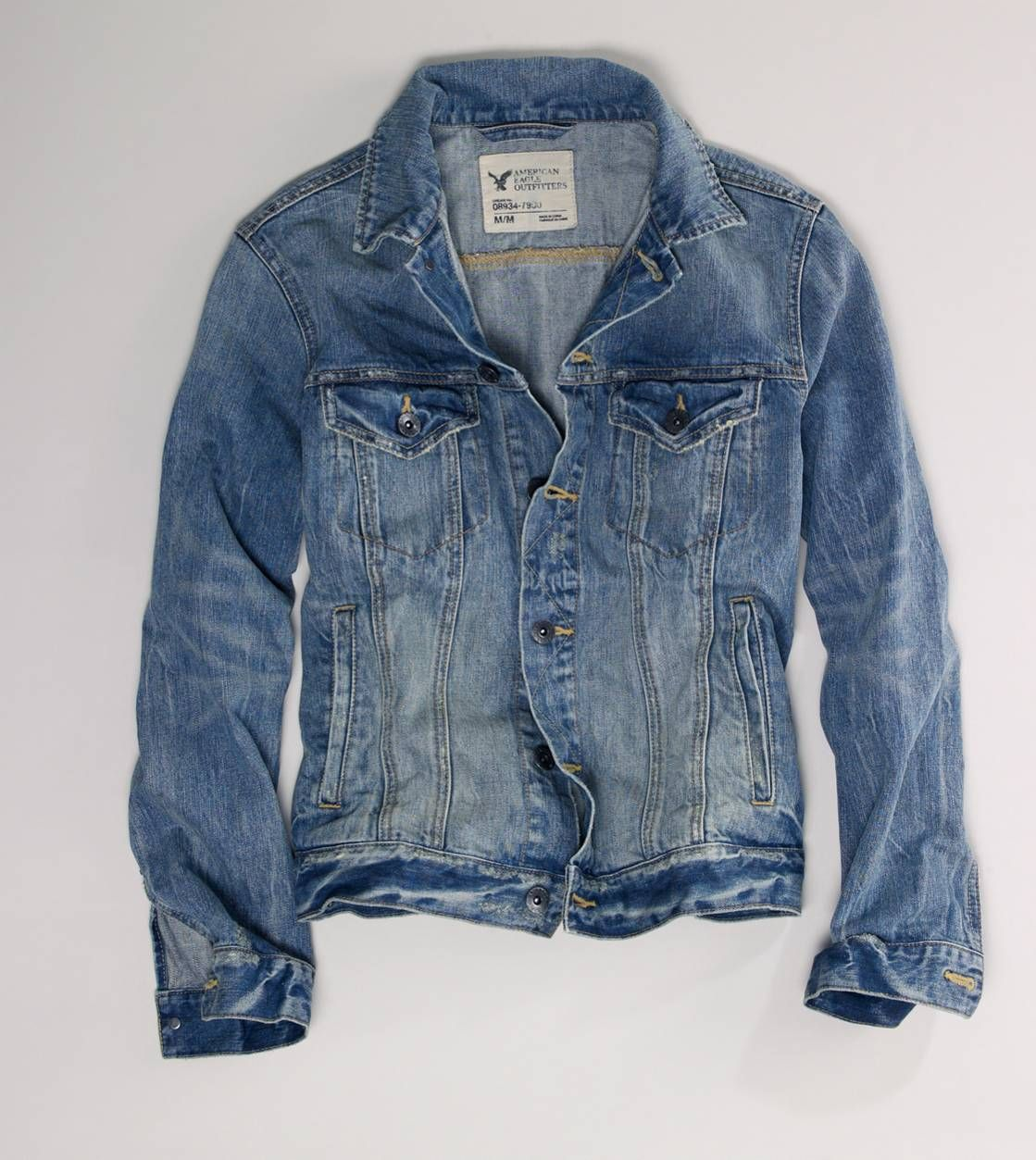 Here is a faded American Eagle jean jacket. The material of this jean jacket  is cotton but the rugged looks makes this item look older and vintage.  rugged ... 43ebb080c8e